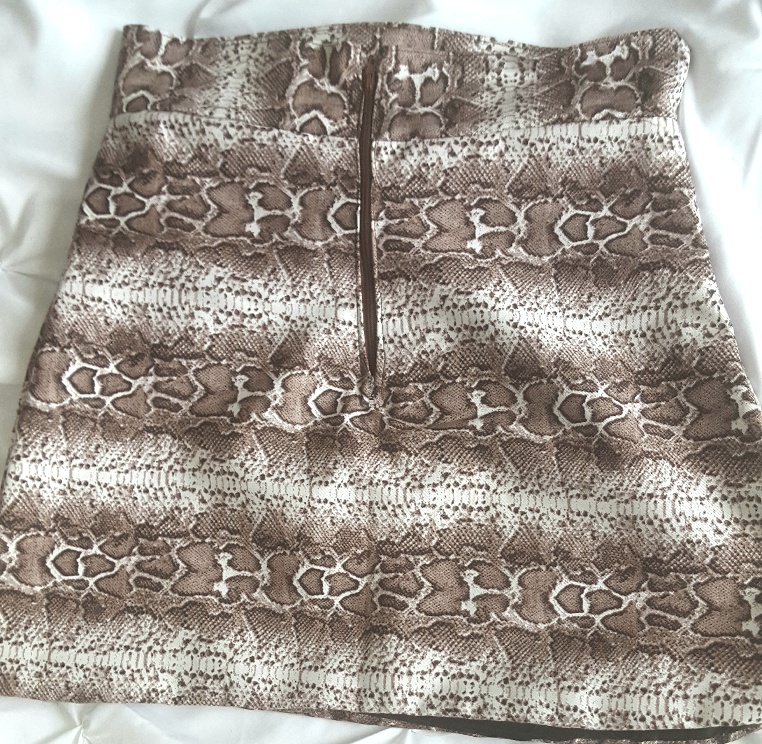 Back of snakeskin print skirt